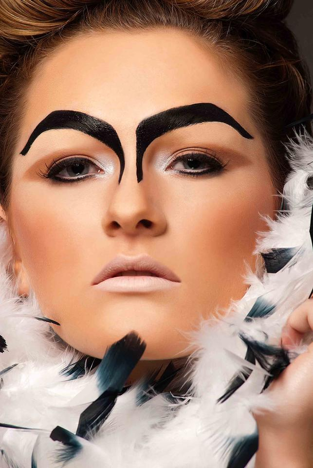 Cosmopolitan magazine photographer, beauty editorial shoot, feathers