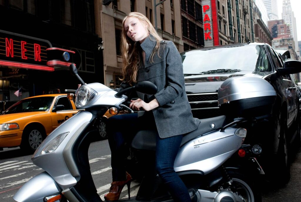 fashion lifestyle image, fashion commercial shoot in Nyc, female model on scooty