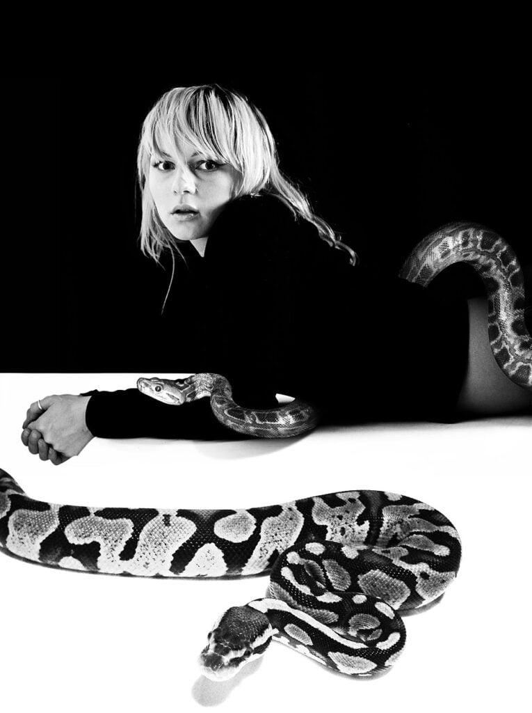 model with snake, female model with python, black and white image with snakes, fashion model shot with snakes