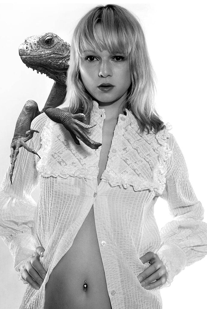 model with snake, female model with python, black and white image with snakes